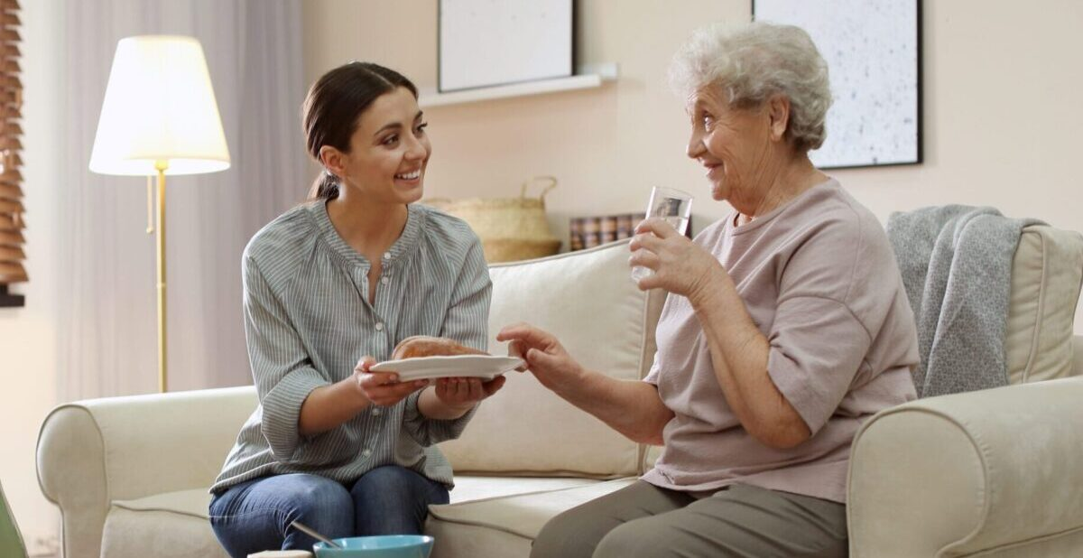 Nurse talking with elderly memory patient